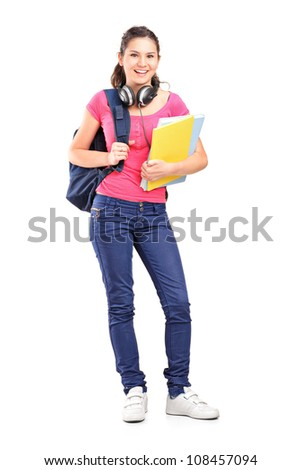 Full length portrait of a female student with headphones, isolated on white background - stock photo