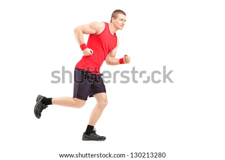 Full length portrait of a fit muscular male athlete running isolated on white background - stock photo