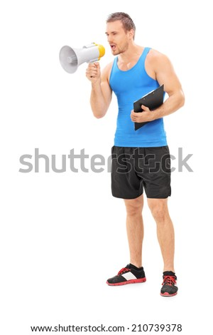 Full length portrait of a fitness instructor shouting on a megaphone isolated on white background - stock photo