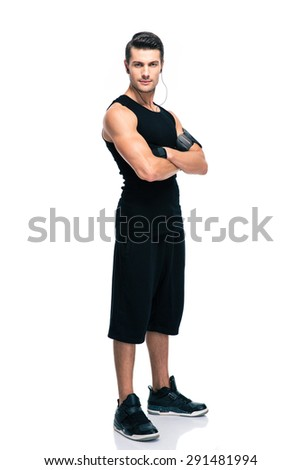 Full length portrait of a fitness man standing with arms folded isolated on a white background. Looking at camera - stock photo