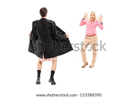 Full length portrait of a flasher scaring a young woman, isolated on white background - stock photo