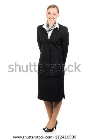 Full length portrait of a friendly young beautiful air hostess. Isolated over white. - stock photo