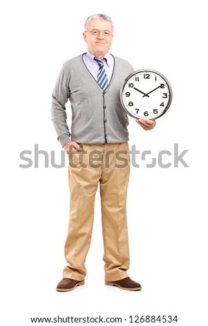 Full length portrait of a gentleman holding a wall clock isolated on white background