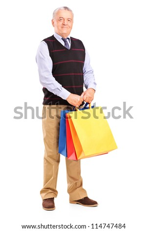 Full length portrait of a gentleman holding shopping bags, isolated on white background
