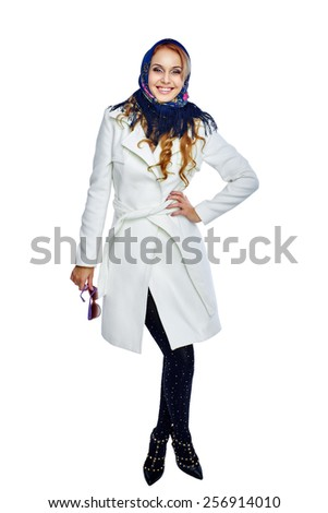Full length portrait of a girl in a white coat smiling. Isolated on white background - stock photo