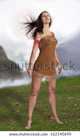 Full-length portrait of a girl on nature background - stock photo