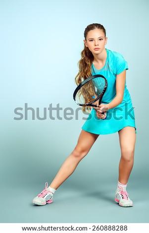 Full length portrait of a girl tennis player. Studio shot. - stock photo