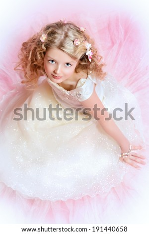 Full length portrait of a girl with beautiful gentle appearance in white festive dress. Over pink background. - stock photo