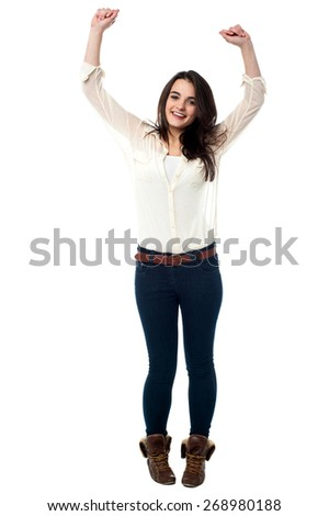 Full length portrait of a gorgeous young girl dancing in joy. - stock photo