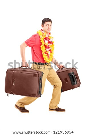 Full length portrait of a guy carrying very heavy travel bags and gesturing isolated on white background - stock photo