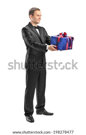 Full length portrait of a guy holding a present isolated on white background