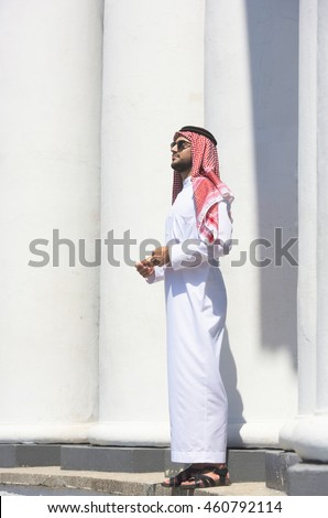 Full-length portrait of a handsome arabian man