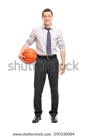Full length portrait of a handsome businessman holding a basketball isolated on white background - stock photo
