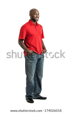 Full length portrait of a handsome late 20s black man looking to the side isolated on white background