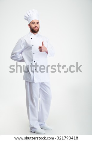 Full length portrait of a handsome male chef cook showing thumb up sign isolated on a white background - stock photo