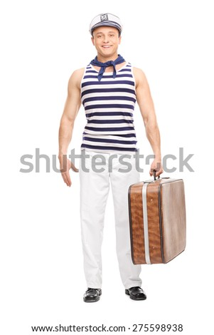 Full length portrait of a handsome young sailor holding a brown bag and looking at the camera isolated on white background - stock photo