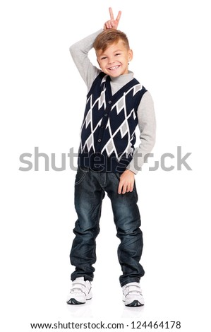 Full length portrait of a happy boy keeping two fingers above head isolated on white background - stock photo