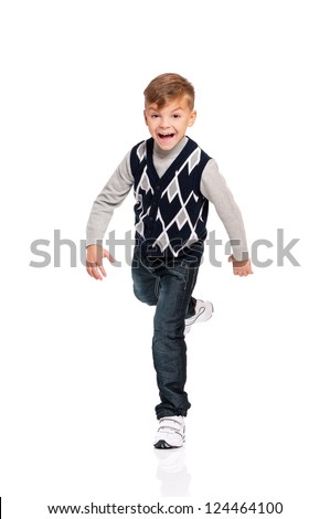 Full length portrait of a happy boy running isolated on white background - stock photo