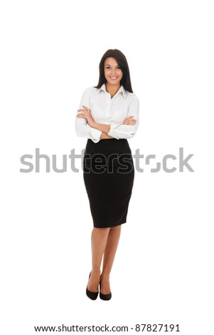 Full length portrait of a happy business woman standing with folded hands isolated over white background