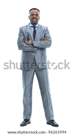 Full length portrait of a happy businessman standing against isolated white background