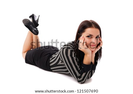 Full length portrait of a happy businesswoman lying on the floor isolated on white background