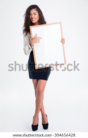 Full length portrait of a happy businesswoman showing blank board isolated on a white background - stock photo