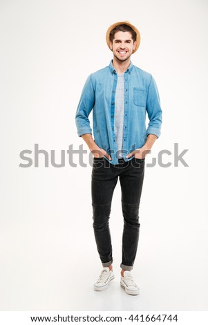 Full length portrait of a happy casual man standing isolated on a white background - stock photo