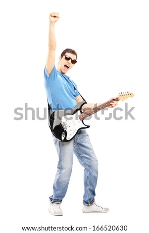 Full length portrait of a happy guy playing on an electric guitar isolated on white background - stock photo