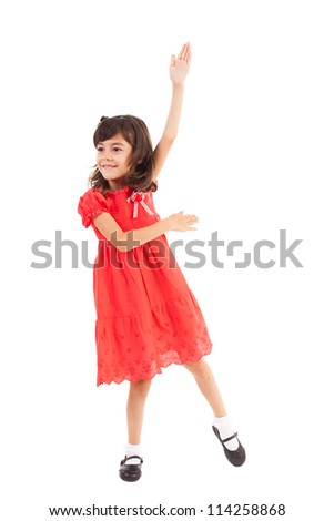 Full length portrait of a happy little girl playing, isolated on white background