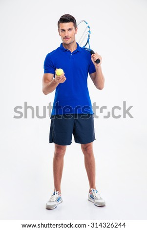 Full length portrait of a happy male tennis player standing isolated on a white background and looking at camera - stock photo