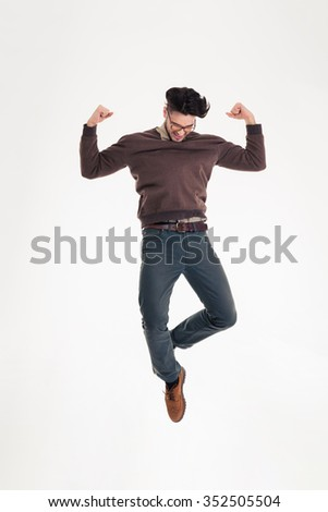 Full length portrait of a happy man celebrating his success isolated on a white background - stock photo