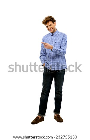 Full length portrait of a happy man showing something to the side - stock photo