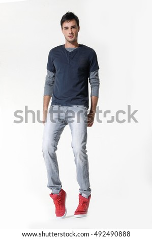 Full length portrait of a happy man standing over white background