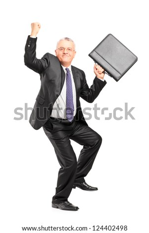 Full length portrait of a happy mature businessperson with raised hands and briefcase isolated against white background - stock photo