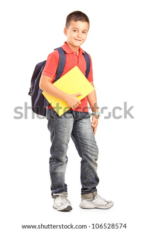 Full length portrait of a happy school boy with backpack holding a notebook isolated on white background - stock photo