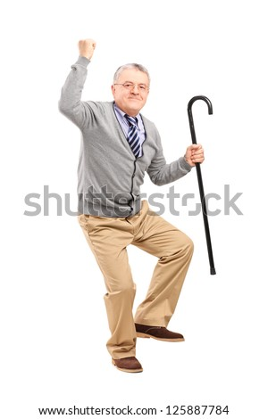 Full length portrait of a happy senior man holding a cane and gesturing happiness isolated on white background - stock photo