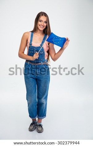 Full length portrait of a happy woman holding european union flag isolated on a white background. Looking at camera - stock photo