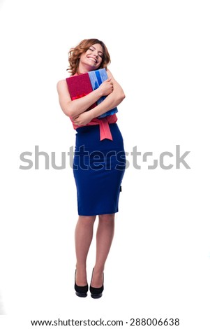 Full length portrait of a happy woman holding gifts isolated on a white background - stock photo