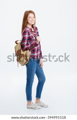 Full length portrait of a happy woman standing isolated on a white background - stock photo