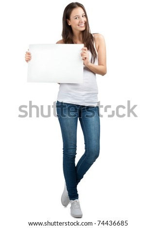Full length portrait of a happy young casual woman standing and holding a blank signboard, isolated on white background - stock photo