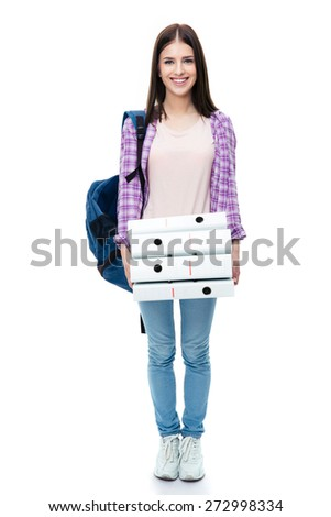 Full length portrait of a happy young female student with backpack and folders over white background. Looking at camera - stock photo