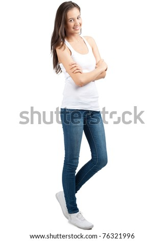 Full length portrait of a happy young woman standing with folded hands against white background