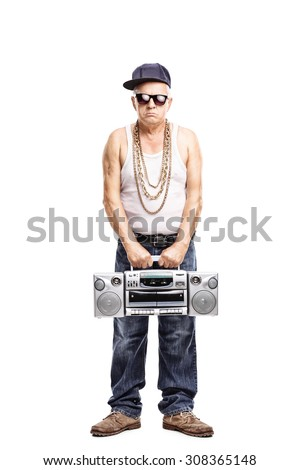 Full length portrait of a hardcore rapper holding a ghetto blaster and looking at the camera isolated on white background - stock photo