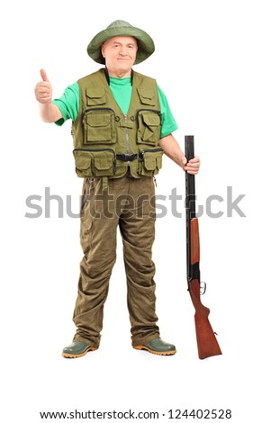 Full length portrait of a hunter holding a rifle and giving a thumb up isolated on white background