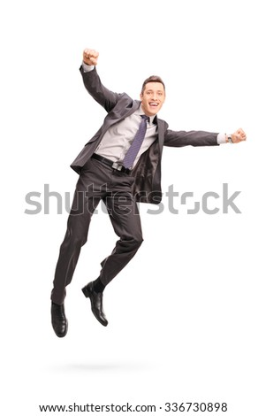 Full length portrait of a joyful businessman jumping in the air and gesturing happiness isolated on white background - stock photo