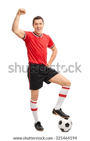 Full length portrait of a joyful football player gesturing happiness and looking at the camera isolated on white background - stock photo