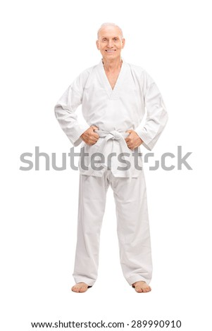 Full length portrait of a joyful senior in a white kimono with a white belt looking at the camera and smiling isolated on white background - stock photo