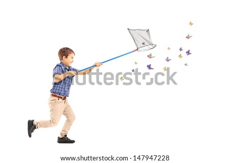 Full length portrait of a kid running and catching butterflies with net isolated on white background - stock photo