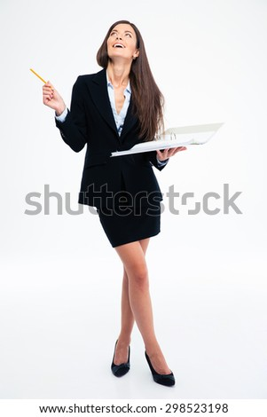 Full length portrait of a laughing woman holding paper with documents and looking up isolated on a white background - stock photo