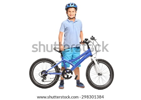 Full length portrait of a little boy with a blue helmet posing with his bicycle isolated on white background - stock photo